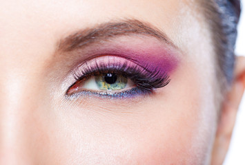 Close up of female eye with bright pink makeup