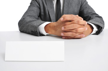 Wall Mural - man in suit sitting in a desk with a blank signboard in front of