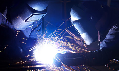 Welders on the industrial workplace