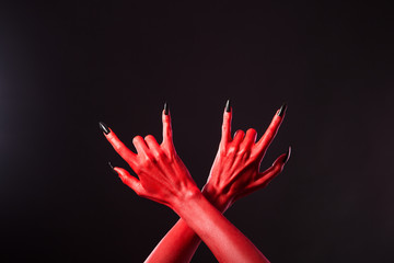 Red devil hands showing heavy metal gesture