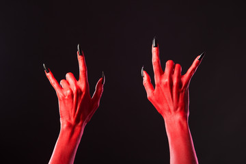 Red devil hands showing heavy metal