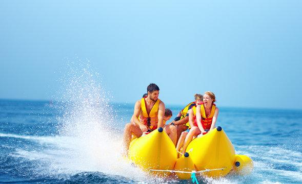 happy people having fun on banana boat