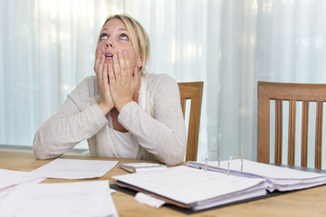 Economic crisis - woman with unpaid bills