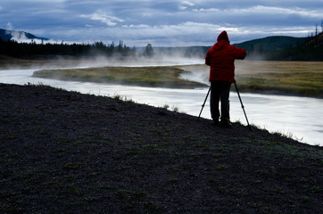 Photographer on Madison River in Yellowstone National Park