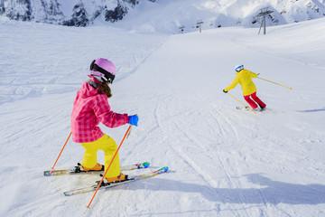 Ski, skiers on ski run - girl skiers skiing downhill