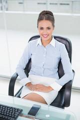 Smiling businesswoman sitting at desk