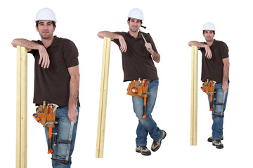 Carpenter posing with a plank of wood