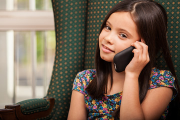 Cute little girl on the phone