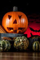 Dark composition of halloween pumpkins