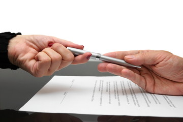 businessman giving pen to businesswoman for signing contract or
