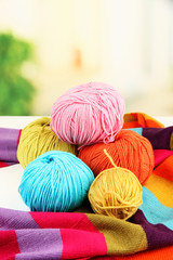 Multicolored clews with bright scarf closeup
