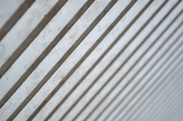 Light and Shadows on modern columns in diagonal as abstract art