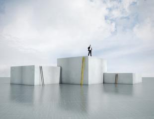 man standing on highest cube