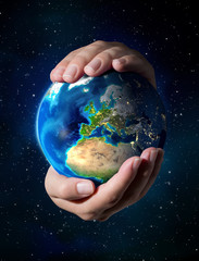Wall Mural - earth in the hands - Europe - universe background