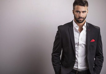 Elegant young handsome man. Studio fashion portrait.