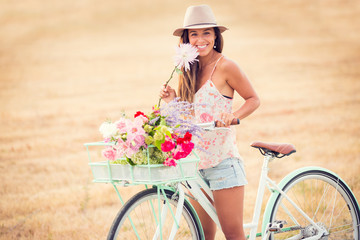 Beautiful young woman on bike