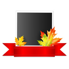 photo with a red ribbon and autumn maple leaves isolated on whit