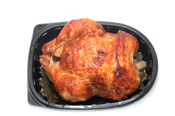 Roasted chicken in a commercial plastic container
