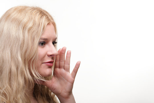 beautiful girl talking speaking out hands mouth white background