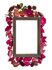 Wooden  photo frame surrounded with dry flowers petal