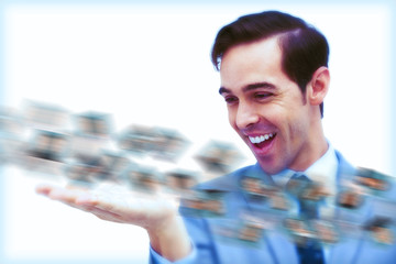 Amused businessman looking at a picture stream