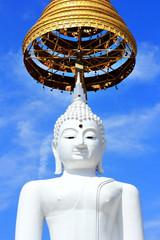 white  Buddha  image on blue sky background