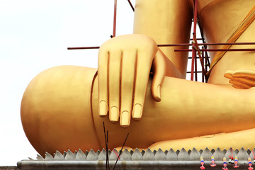 Golden hand Buddha statue under construction
