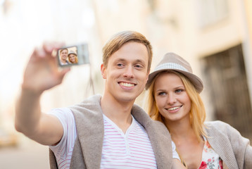travelling couple taking photo picture with camera