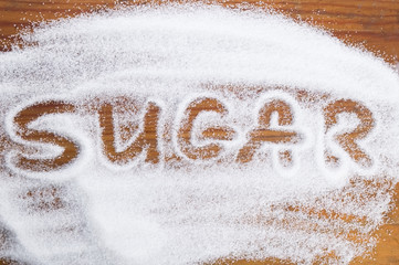 The word sugar written into a pile of white granulated sugar Wall mural