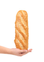 Sliced white bread on a hand.