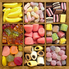 Assorted candy in a wooden box