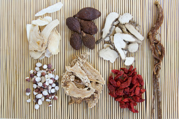 Chinese herb medicine ingredints on a bamboo mattress