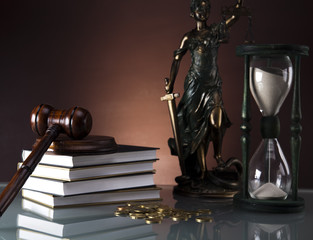 gavel and books, Statue of Lady Justice, coins, hourglass