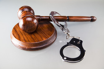 Law gavel and handcuffs, A pair of handcuffs and gavel