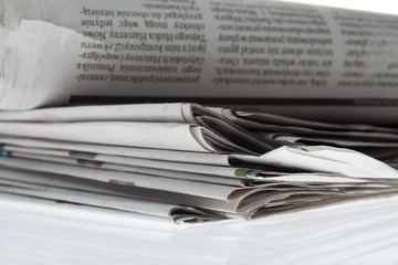 Newspapers folded and stacked concept