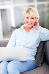beautiful mature woman using laptop at home