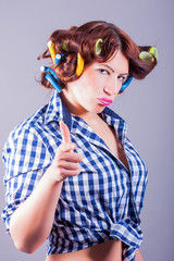 attractive woman with curlers in her hair