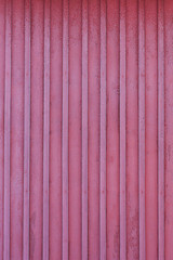 Frost red wall of wooden house at winter