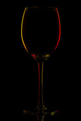 Colored glass silhouette over black background