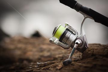 Printed roller blinds Fishing fishing reel. blur background