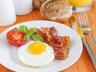 Fried egg and bacon for breakfast
