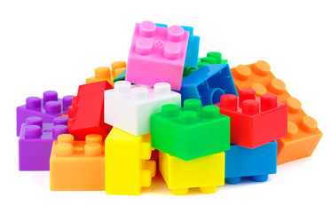 Toy plastic colorful blocks on white background