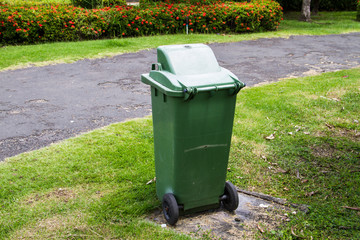 Green trash can in the park