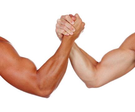 Two powerful men arm wrestling