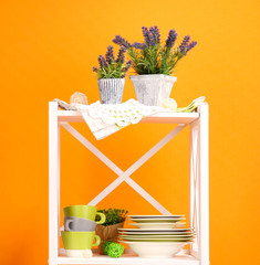 Beautiful white shelves with tableware and decor,