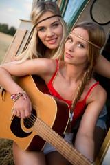 cute hippie girls making music