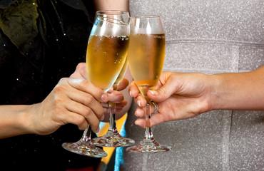 women holding champagne glasses