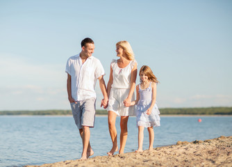 Wall Mural - happy family at the seaside