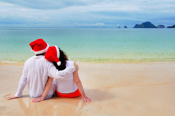 Christmas and New Year, romantic couple on beach vacation