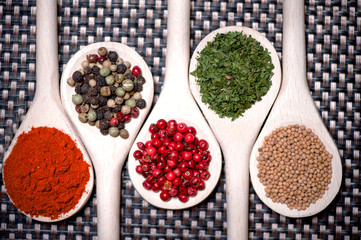 assortment mix of colorful spices with chopped parsley, mustard